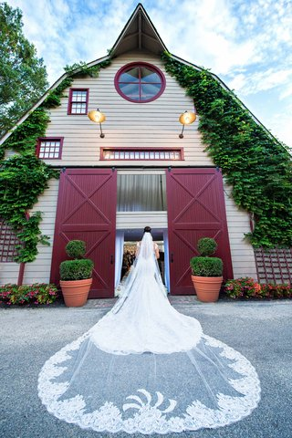 megan-wollover-at-new-jersey-wedding-venue-with-lace-trim-ines-di-santo-cathedral-wedding-veil
