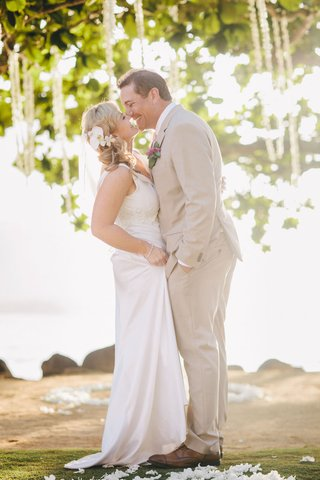 man-in-khaki-suit-and-brown-shoes-kissing-bride