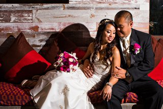 bride-and-groom-at-hotel-maya-with-pink-flowers