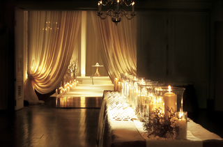 table-outside-ceremony-with-escort-cards-and-candles