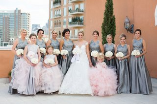 grey-high-neck-bridesmaid-dresses-pleated-skirt-white-bouquets-pink-flower-girl-and-junior-maids