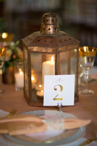 lantern-with-candle-and-white-table-number-with-gold-calligraphy-and-gold-foil-number-details-rustic
