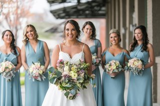 bride-in-modern-trousseau-ball-gown-spaghetti-straps-and-pockets-mismatched-bridesmaids-in-blue