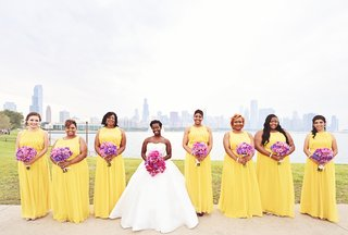 bridesmaids-in-long-yellow-dresses-purple-bouquets-with-bride-in-strapless-pnina-tornai-ball-gown