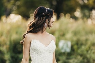 brunette-bride-with-soft-waves-and-delicate-bridal-halo-wearing-lace-gown-with-sweetheart-neckline