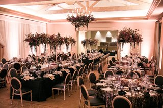 modern-wedding-reception-with-black-linens-black-chairs-dark-purple-florals-kings-tables