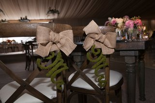 rustic-wooden-chairs-enchanted-decoration-burlap-moss-natural-bow