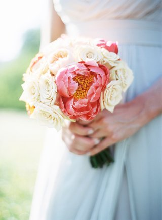 bridesmaid-holding-bouquet-of-white-roses-and-hot-pink-peonies