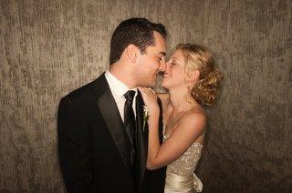groom-in-black-tux-looks-at-bride-in-ivory-wedding-dress