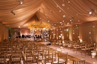 tented-wedding-ceremony-with-hanging-flowers