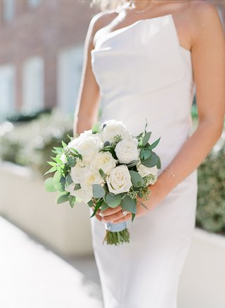 bridal-bouquet-with-white-roses-and-eucalyptus-leaves-wrapped-with-pale-blue-ribbon