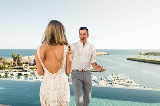 first-look-reveal-in-destination-wedding-in-cabo-bride-with-backless-lace-dress