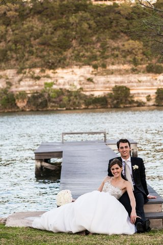 young-couple-on-dock-of-lake-in-austin-texas