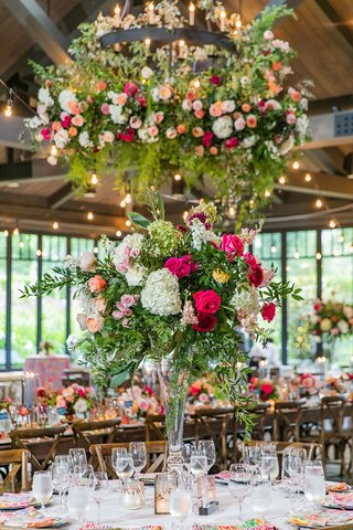 wedding-reception-flowers-on-industrial-chandelier-centerpiece-pink-white-flowers-colorful-linens