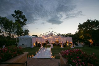 walkway-filled-with-candles-welcomed-guests-inside-the-tent