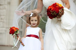 flower-girl-with-marsala-red-ribbon-belt