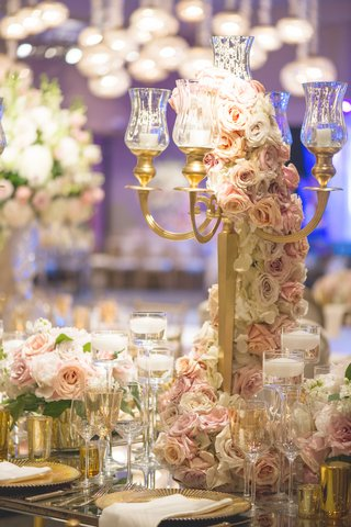 wedding-reception-table-with-gold-candelabra-light-orange-purple-pink-roses-white-hydrangeas