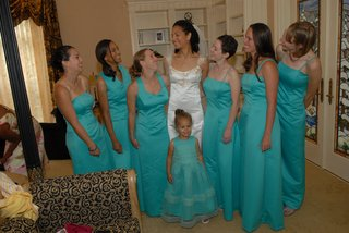 bride-in-a-reem-acra-gown-with-bridesmaids-in-long-teal-dresses