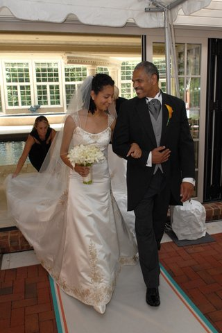 bride-in-a-reem-acra-gown-walking-with-her-father-in