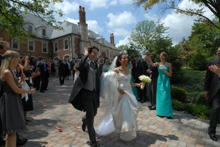 bride-in-a-reem-acra-gown-with-groom-in-black-tails-and-grey-vest-exit-ceremony