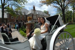 bride-in-a-reem-acra-gown-with-groom-on-a-white-carriage