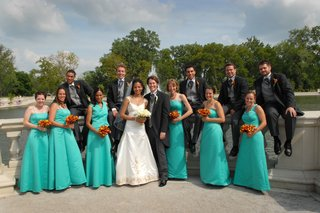 bride-and-groom-with-bridesmaids-in-long-teal-dresses-and-groomsmen-in-tails