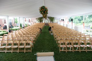 tented-wedding-ceremony-with-floral-arrangements-suspended-over-the-aisle