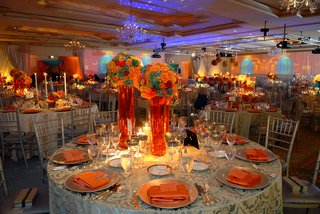 wedding-reception-table-with-colorful-centerpieces-in-tall-vases