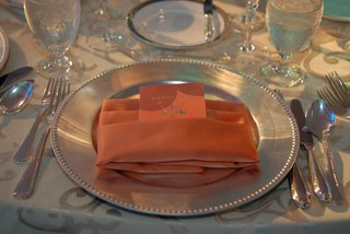 wedding-reception-menu-in-the-form-of-an-orange-passport-in-napkin