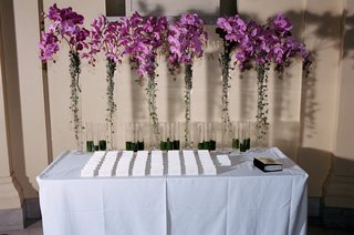 asian-inspired-table-with-escort-cards-and-purple-flowers