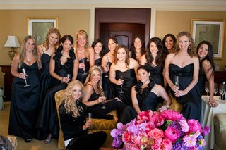 bride-getting-ready-with-bridesmaids-in-black-dresses