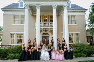 bride-with-pink-flower-girls-and-black-bridesmaid-dresses