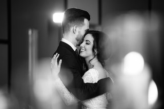 black-and-white-photo-of-newlyweds-hugging