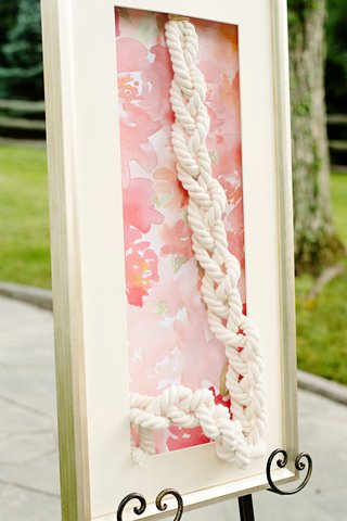 wedding-ceremony-white-frame-with-flower-print-backdrop-strong-cord-unity-braid-ritual
