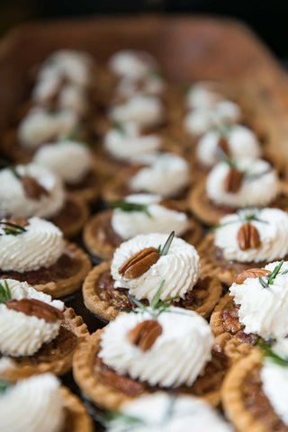 wedding-desserts-miniature-pecan-pie-with-pecan-on-top-whipped-cream