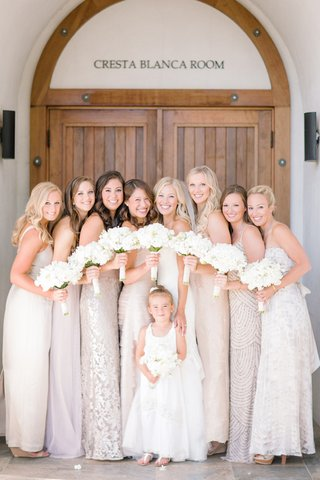 bride-with-mismatched-bridesmaid-dresses-white-bouquets-and-flower-girl-in-sandals