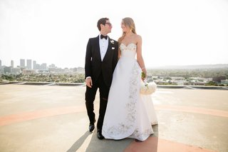 bride-in-oscar-de-la-renta-wedding-dress-and-groom-in-tuxedo-on-los-angeles-rooftop-portrait-photo