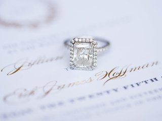 diamond-engagement-ring-with-emerald-cut-diamond-and-halo-pave-band