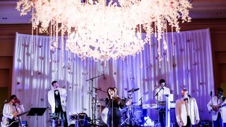 reception-band-performing-floral-chandelier-singing-classic-dallas-texas-wedding-purple-blue-uplight