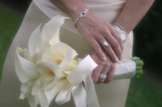 the-bride-carried-a-white-bouquet-and-wore-a-dazzling-bracelet-and-watch-for-her-wedding