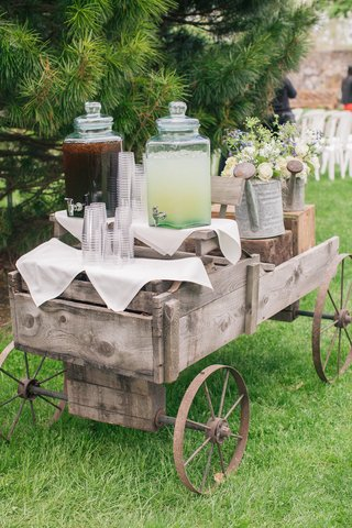 antique-cart-with-glass-drink-canisters-and-cups