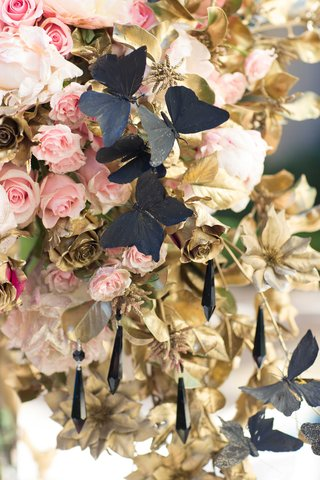 large-floral-centerpiece-alexander-mcqueen-chanel-pink-roses-black-butterflies-hanging-jewels