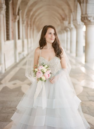 bride-in-hayley-paige-wedding-dress-grey-silver-beaded-bodice-pink-peony-white-rose-flowers-veil