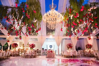 tent-wedding-reception-watercolor-dance-floor-chandelier-roses-hanging-from-trees-gold-chairs