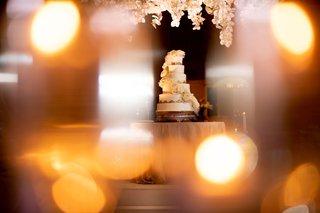 wedding-reception-acrylic-arbor-white-flowers-cascading-rose-on-six-layer-wedding-cake-gold-filigree
