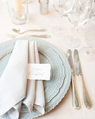 wedding-reception-place-setting-light-blue-charger-plate-light-grey-napkin-torn-place-card
