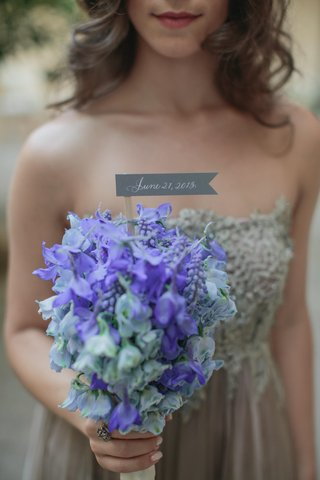 bridesmaid-holds-bouquet-of-blue-flowers