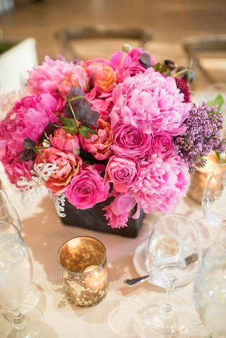 wedding-floral-centerpiece-with-vibrant-pink-flowers
