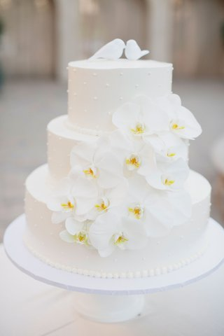 three-tier-wedding-cake-with-orchids-3d-polka-dots-lovebird-cake-toppers