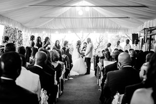 black-and-white-photo-of-tent-wedding-ceremony-african-american-couple